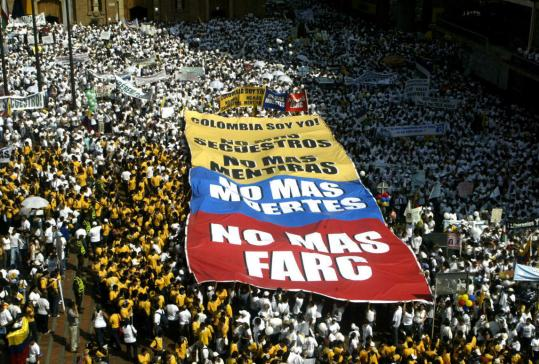 Hundreds of people held a banner reading 'No More FARC. No More Deaths. No More Lies. No More Kidnappings. I Am Colombia' in Cali, Colombia, yesterday.
