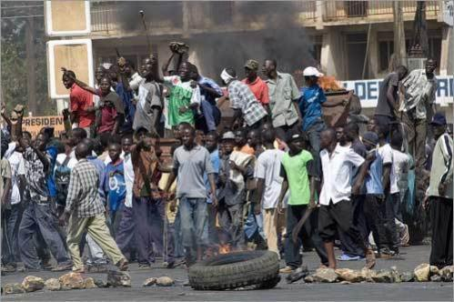 An angry mob of followers of Kenya's opposition leader Raila Odinga shout as they block a road during a demonstration in the western town of Kisumu. Violent clashes erupted in the western town and nearby Kericho after David Kimutai Too from Odinga's Orange Democratic Movement (ODM) was killed by a traffic policeman.