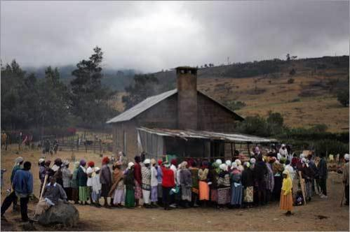 Women belonging to the Kikuyu tribe make a line to be fed a meal of maize at a makeshift kitchen that hundreds of them are using as a camp in the grounds of a monastery in the central Kenyan town of Kepkelion. Some 140 families sought refuge from post-election ethnic violence at the monastery and have had members of the Kalenji tribe attack them on the periphery of the monastery on several ocassions.