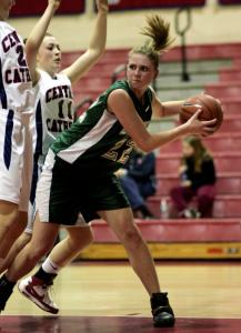 Billerica's Brittney McGinness looks for a way around two Central Catholic defenders.