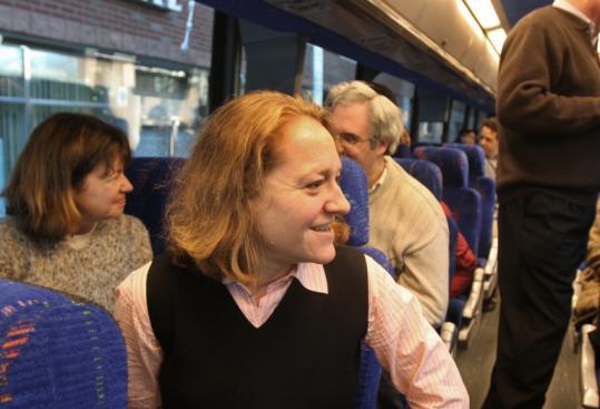 Karen Smith (left) and Mary-Helen Nsangou, of Allston Brighton Community Development Corporation, on the bus.