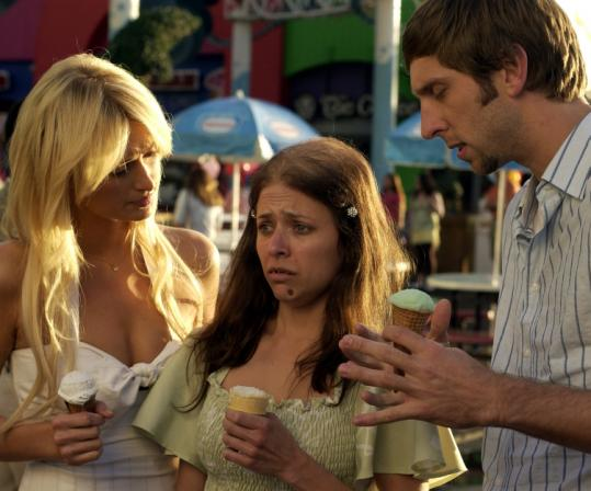 Paris Hilton (left), Christine Lakin, and Joel David Moore star in this low-budget knockoff of a Farrelly brothers classic.