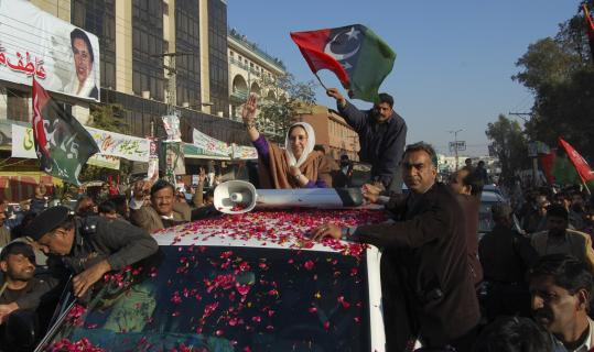 Benazir Bhutto waved as she arrived at her last public rally in Rawalpindi, Pakistan, on Dec. 27. British investigators ruled out that the head injury could have been caused by a bullet.