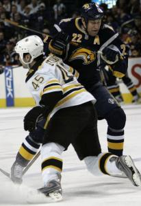 The Sabres' Adam Mair takes a trip, courtesy of Bruins defenseman Mark Stuart, during the first period.