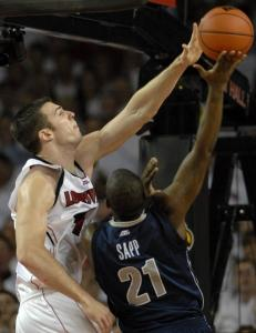 Louisville's David Padgett shows he has the right stuff by rejecting Georgetown's Jessie Sapp in the second half.