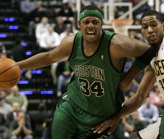 Paul Pierce, who had a game-high 28 points for the Celtics, uses a little elbow grease to work his way past Indiana forward Danny Granger.
