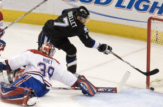 Tampa Bay's Michel Ouellet slips the puck past Montreal goalie Cristobal Huet.