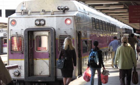 Commuters about to board a Worcester-bound train at South Station last October.