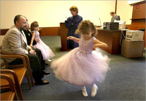 Five year old Eileen Estremera shows off her best pirouette for the court on the day that she and her twin sister Esther were officially adopted by their new parents Marcos and Gladys Estremera, at left.