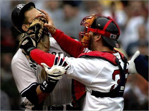 Boston Red Sox catcher Jason Varitek and Alex Rodriguez of the New York Yankees tangle in a third inning bench-clearing brawl that lit a fire under the Red Sox team which up until then had no real team identity. The Red Sox's unwillingness to quit in the face of adversity directly led to their historic comeback in the American League Championship Series when they were three outs from ending their season to their stirring four-game sweep to win the 2004 World Series.