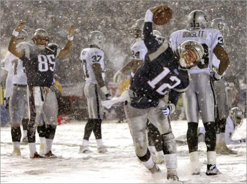 Patriots quarterback Tom Brady spikes the ball after scoring a touchdown against the Oakland Raiders in the AFC Championship game against the Oakland Raiders at Foxboro, MA.