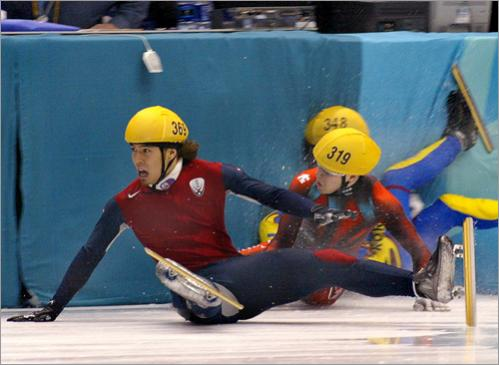Apollo Anton Ohno of the United States crashes in the 1000m short track finals just short of the finish line. Ohno recovered in time to stumble across the finish line and win the Silver medal in the Salt Lake Winter Games.