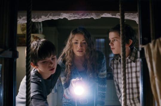 From left, Freddie Highmore, Sarah Bolger, and Freddie Highmore play the Grace siblings.
