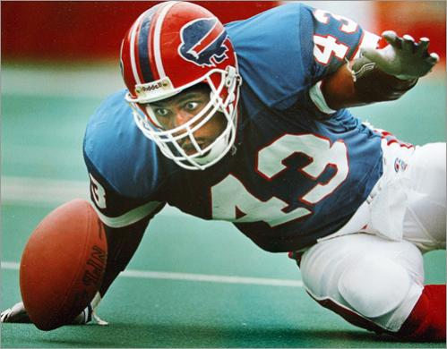 Buy photographs by Jim Davis Buffalo Bills DB Matt Darby's eyes light up as he is about to pounce on and recover a fumble by the Patriots Leonard Russell during a 1993 game.