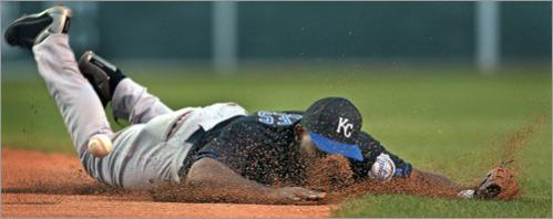 Buy photographs by Jim Davis Kansas City Royals' second baseman Carlos Febles got a face full of Fenway Park dirt as he dove for Red Sox Trot Nixon's bouncer during a 2003 game.