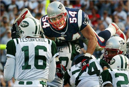 Buy this picture! Patriots linebacker Tedy Bruschi goes over the Jets offensive line in pursuit of New York quarterback Vinny Testaverde as the visitors try to come back and tie the game in the fourth quarter.