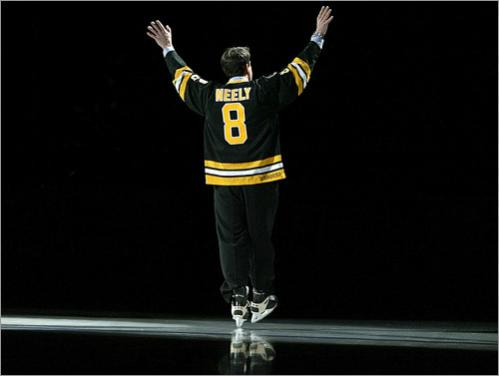 Buy this picture! Former Boston Bruins' right winger Cam Neely had his number '8' retired at the FleetCenter prior to a 2004 game. He surprised the cheering fans by donning his jersey, and taking a skate around the ice for an appropriate entrance.