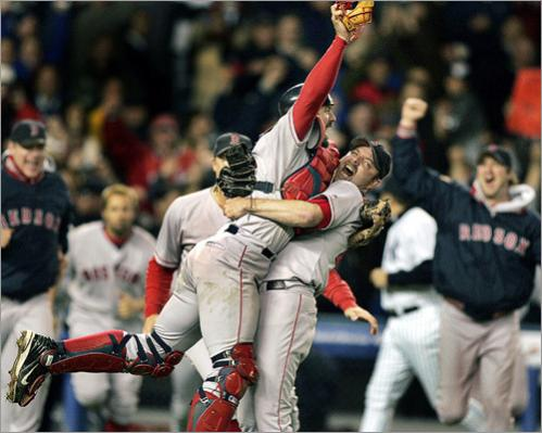 Buy photographs by Jim Davis Red Sox Jason Varitek and Alan Embree embrace as the rest of the Boston players rush out of the Yankee Stadium visitors' dugout to celebrate following the final out of Game 7 of the 2004 American League Championship Series that sent them to the World Series.