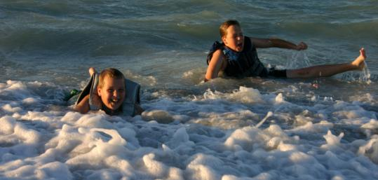 The McCullough brothers of Apopka, Fla., Nick, 10, left, and Noah, 12, stirred up the surf in the Gulf of Mexico on their first visit to Cayo Costa State Park last December.