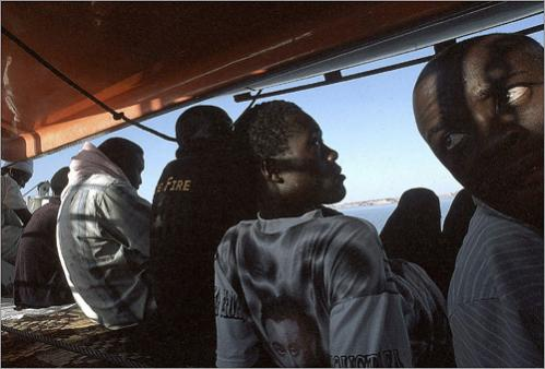Dinka teenagers from the southern part of Sudan look cross Lake Nasser as they embark in a quest for a better life in Egpyt, their final destination.
