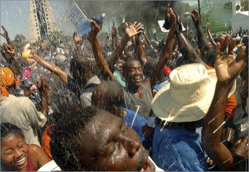 During a rally to celebrate the departure of deposed president Jean-Bertrand Aristide in Port-Au-Prince, Haiti, water was thrown to the demonstrators to cool them off.