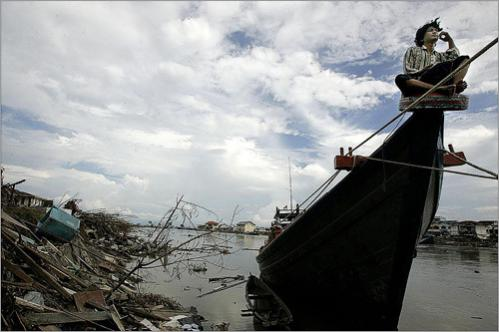 At the Shores of the Aceh River, in Banda Aceh, Indonesia, Dedy Gudriansyah guards what he said was his only belonging left in the world, his boat Juale Baro (new fish), two weeks after a killer tsunami leveled most of the city and killed more than 250,000 people in South East Asia.