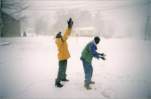 Buy this picture! Upon their arrival in Boston the Lost Boys of Sudan found themselves in a fresh wilderness. Here they enjoy their first snowfall in Oxford, MA in their new foster home. They were engines of questions. Why don't black people live outside the city? Why don't American trees have leaves? Why are poor people fat and rich people thin?