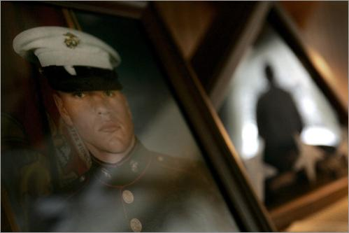 Buy photographs by Bill Greene James Schulze looks out the living room window as a photo of his son Jonathan Schulze sits on a desk. Jonathan committed suicide in January in Stewart, Minnesota after returning home from Iraq and suffering from PTSD. He was turned away from the VA.