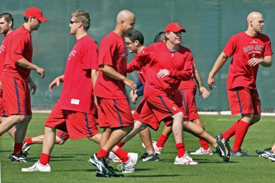 That's entertainment? Among the compelling dramas NESN will broadcast live from Fort Myers will be Red Sox conditioning drills such as this one.