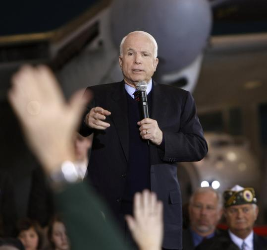 John McCain, who appeared at a town hall meeting in Oshkosh, Wis., yesterday, has sided with President Bush on key votes related to interrogations and warrantless surveillance.