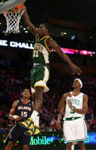 Jeff Green of the Rookie team dunks over Celtic Rajon Rondo from the Sophomore squad but the older team prevailed.