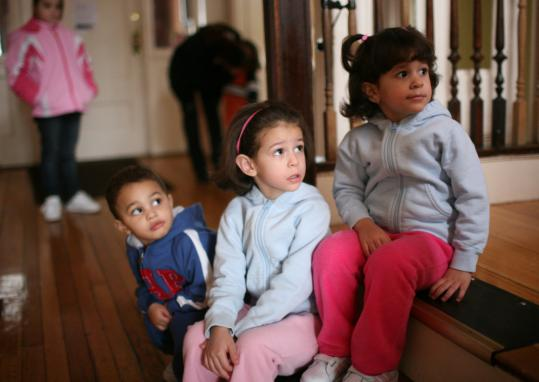 Jahsiem Guerrier (left), 2, Imalay Checo, 4, and Ivette Checo, 3, at Casa Nueva Vida yesterday. The Jamaica Plain shelter houses homeless single mothers and children. Nineteen families live in the shelter.