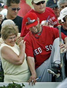 Fan favorite Dustin Pedroia goes over the fence - but it's not a home run, just a shortcut to the playing field.