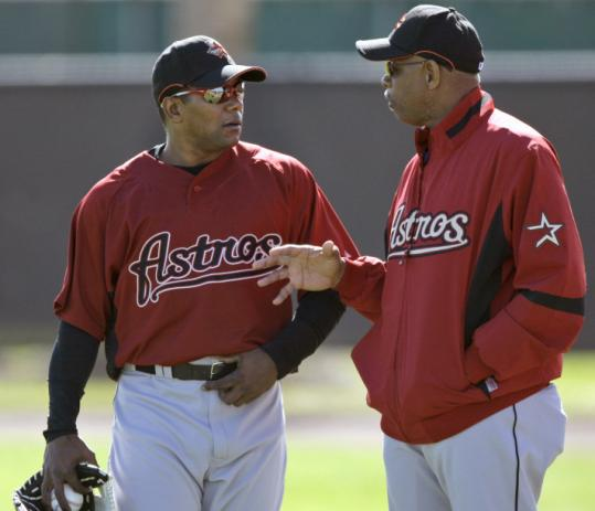 Miguel Tejada (left) expressed his preference to Astros manager Cecil Cooper - he wants to be at SS for every game.