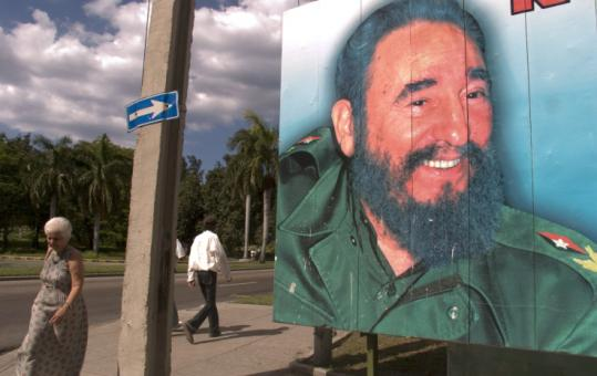 A poster of Fidel Castro, Cuba's outgoing president, loomed over a Havana street yesterday. The ailing Castro announced this week that he would formally relinquish power after nearly 50 years.
