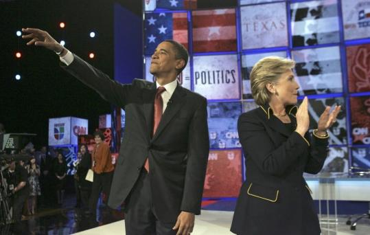 Senators Barack Obama and Hillary Clinton responded to the crowd before tackling the economy and illegal immigration at the presidential debate last night in Austin, Texas.
