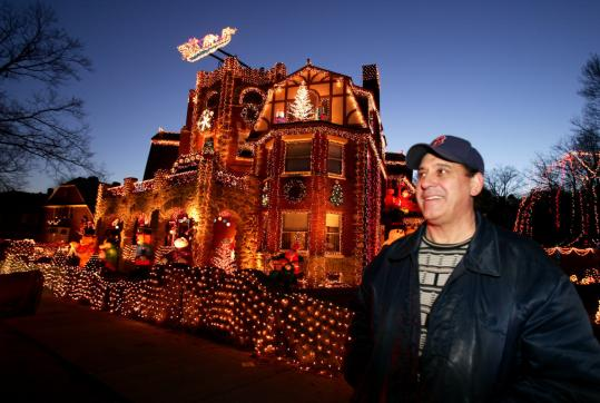 Dominic Luberto stood in front of his home in December 2006. Last year, the house featured a 10-foot-high, 650-pound golden crown, 500,000 lights, and inflatable characters.