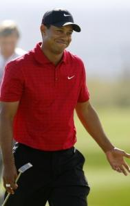 Only Tiger Woods could laugh after a 35-foot eagle putt lipped out, costing him a hole.