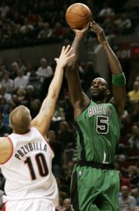 Portland's Joel Przybilla makes a short-armed attempt to block this jumper by Kevin Garnett, who finished with 10 points.