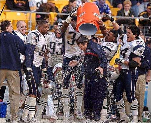 Buy photographs by Matthew J. Lee New England Patriots head coach Bill Belichick gets a Gatorade bath after Drew Bledsoe replaced an injured Tom Brady to lead the Patriots to a 24-17 upset of the Pittsburg Steelers in the 2002 AFC Championship Game at Heinz Field in Pittsburgh.