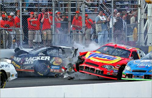Buy this picture! Martin Truex Jr. (left) crashes into Travis Kvapil as they cross the finish line of NASCAR's 2006 New Hampshire 300 at the New Hampshire International Speedway in Louden.