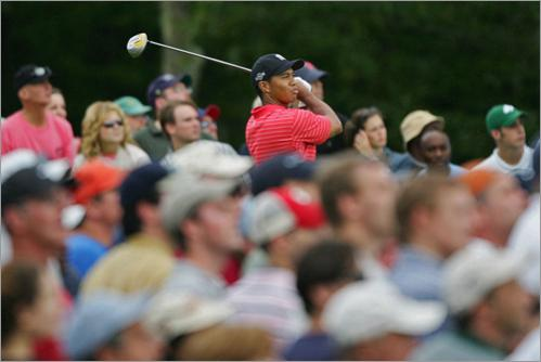 Buy this picture! Tiger Woods and fans watch his tee shot on the 14th hole during the final round of the Deutsche Bank Championship at the TPC of Boston in 2006.