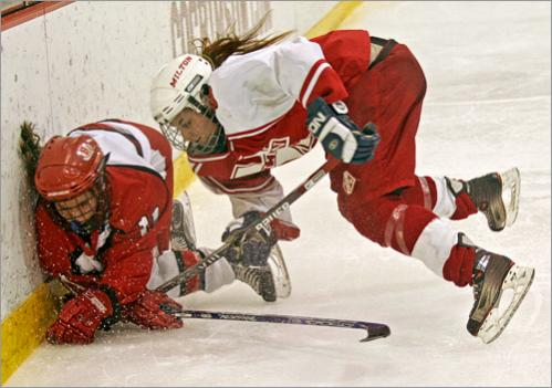 Buy this picture! Barnstable High's Jessi Barron and Milton High's Shana Indelicato crash into the boards during the second period of the MIAA Division 2 State Final at Harvard University in 2007.