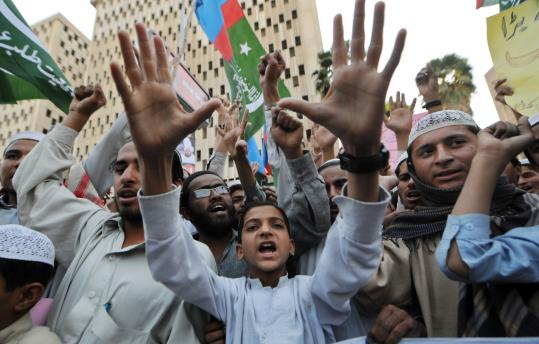 Pakistani activists of Jamiat Talaba Arabia shout anti-Danish slogans during a protest against the publication of drawings depicting the Prophet Mohammad in Karachi recently.