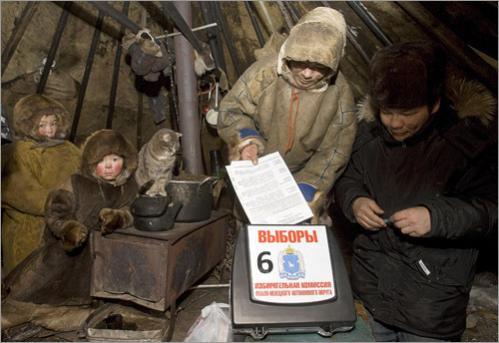 A Nenets man casts his ballot inside a hut.