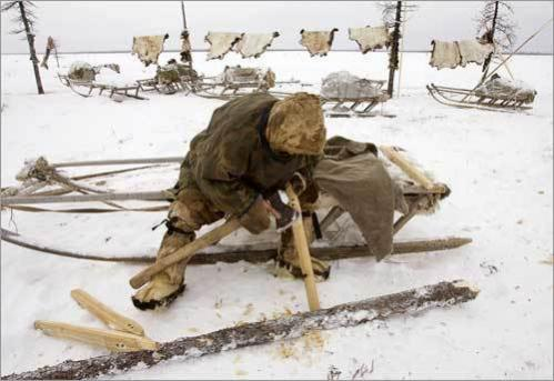A Nenets man works at his settlement in the tundra region near village of Yar-Sale.