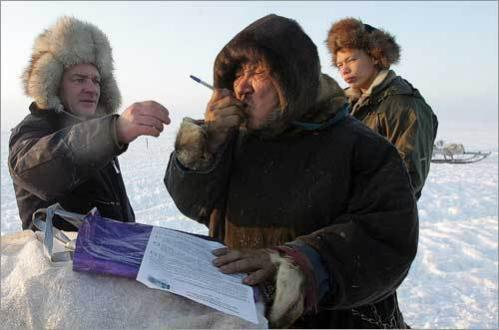 A Nenets deer shepherd warms up a pen to mark his ballot in his tundra camp 125 miles from Russia's west-northern town of Naryan-Mar. There are four registered candidates in Russia's March 2 presidential poll: Communist Party head Gennady Zyuganov, ultranationalist Vladimir Zhirinovsky, unknown Andrei Bogdanov, and President Vladimir Putin's hand-picked successor, Dmitry Medvedev -- the hands-down favorite to win.
