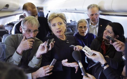 Senator Hillary Clinton spoke with reporters on her campaign plane en route to Ohio, where she convened an economic summit with Governor Ted Strickland and a host of other leaders.