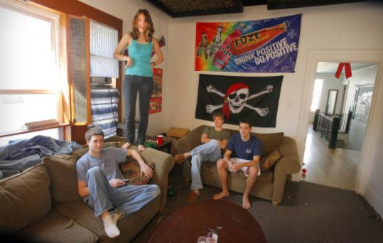 Boston University students and roommates (from left) and Matt Hayden, Meredith Eads, Sam Stratton, and Evan Puschak in their Allston apartment.