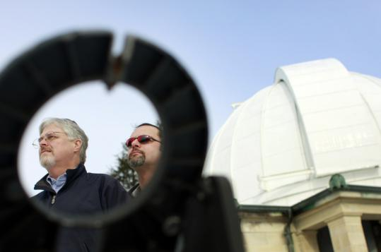 Greg Berghorn (left) and Mark Petty, with Wellesley College's Whitin Observatory as a backdrop, say their Framingham-based group, the Massachusetts Mutual UFO Network, looks into 50 reports of UFO sightings from across the state each year.